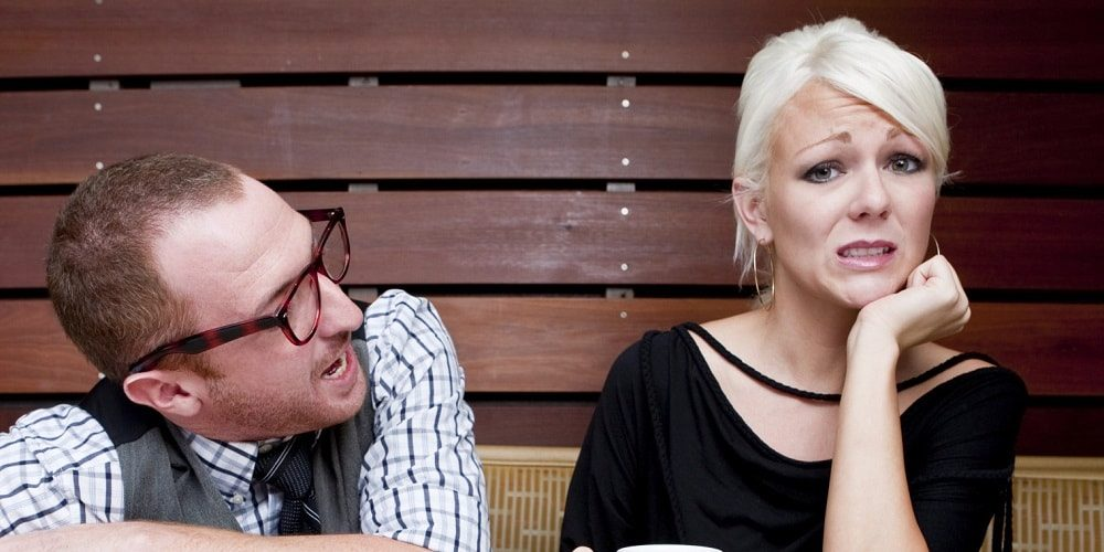 Man and a woman having an awkward a bad first date